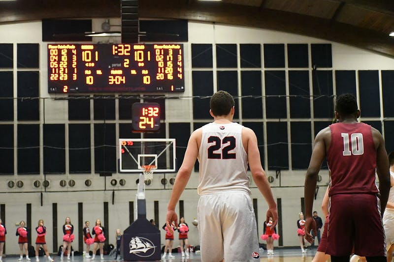 John Castello (22) stands on the low block with Lock Haven's Christian Kelly late in the second overtime of the Raiders' double-overtime loss on Saturday. Castello continued his dominance in the defeat, scoring 23 points and pulling down 15 rebounds.