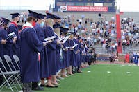 To conclude the traditional ceremony, graduates and attendees sang the SU Alma Mater song.