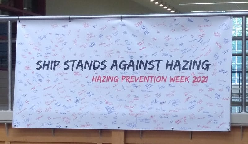 The signed Pledge Against Hazing banner hangs in the CUB's main hall following the university's annual Hazing Prevention Week.