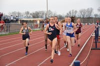 Bella Marchini (front) runs at SU's 2019 outdoor track-and-field invite. In 2019, she placed fifth at the PSAC Championships in the 5,000-meters (5K).