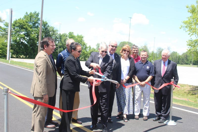 Members of Shippensburg University and the Shippensburg University Foundation, along with local government officials cut a ribbon to signify the opening of the new road on Friday. Pictured is (Left to Right) Michael Ross, of the SU Council of Trustees; Steve Oldt, a Shippensburg Township Supervisor; Barbara Lyman, SU interim president; Joel Zullinger, SU Foundation Board chair; Pennsylvania State Rep. Mark Keller, of the 86th district; Stacey Gregson, field representative from State Sen. Richard Alloway II's office; Bruce Herring, project manager and SU assistant director of planning and engineering; Lance Bryson, SU's associate vice president of facilities management and planning; and John Clinton, the SU Foundation president.