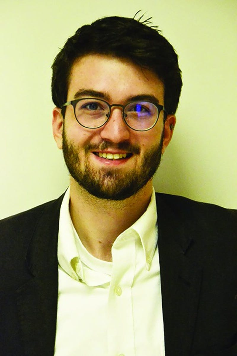 Troy Okum has served as Editor-in-Chief of The Slate for the past year and a half. Okum became involved with The Slate during his second week of college.