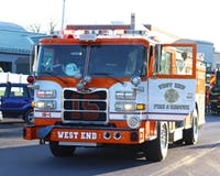One of the three West End Fire and Rescue trucks parks in the lot between the Grace B. Luhrs University Elementary School and the Franklin Science Center.
