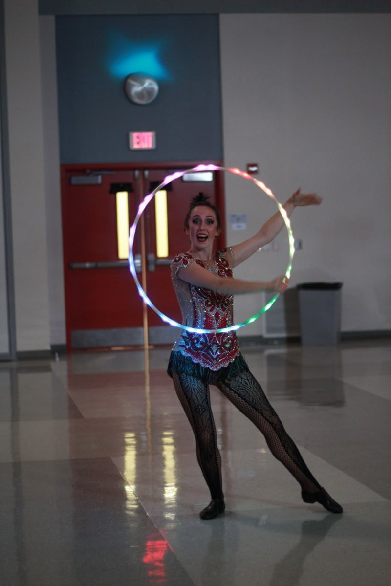 One of the many performances of LSO's Latino Explosion night was a female juggler juggling hula hoops as a part of its circus theme.