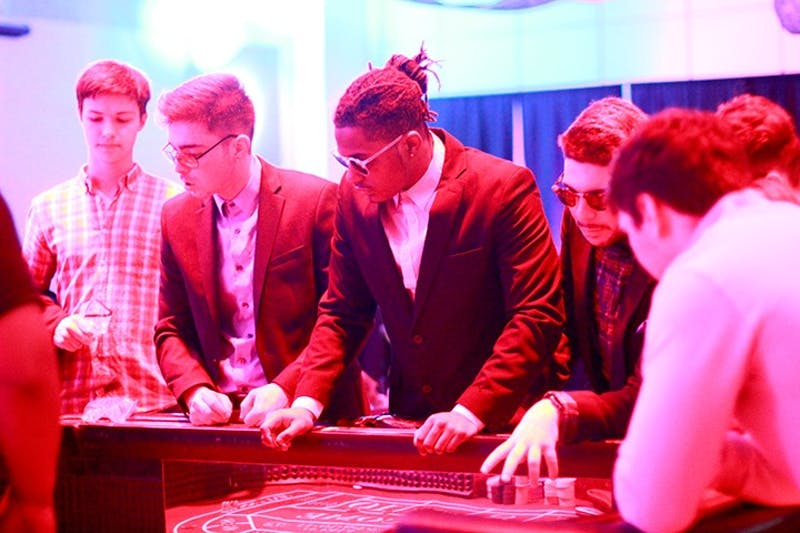 Students fittingly adopt a high roller style at Casino Night Saturday evening.