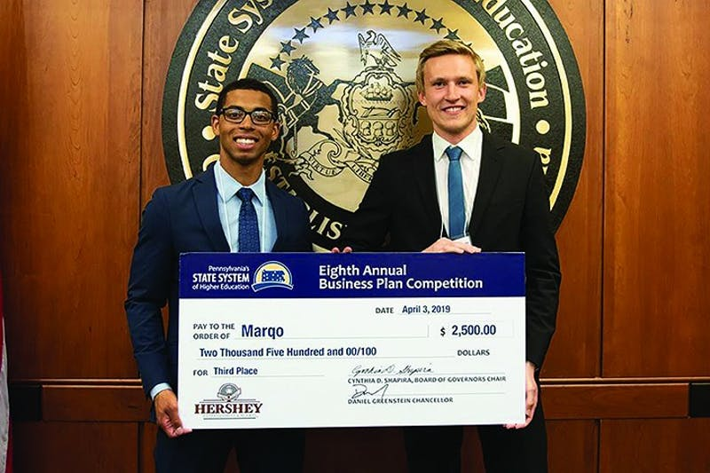 David Brantley (left) and Patrick Luebben were presented with a check after winning third place in this year's Student Business Plan Competition.