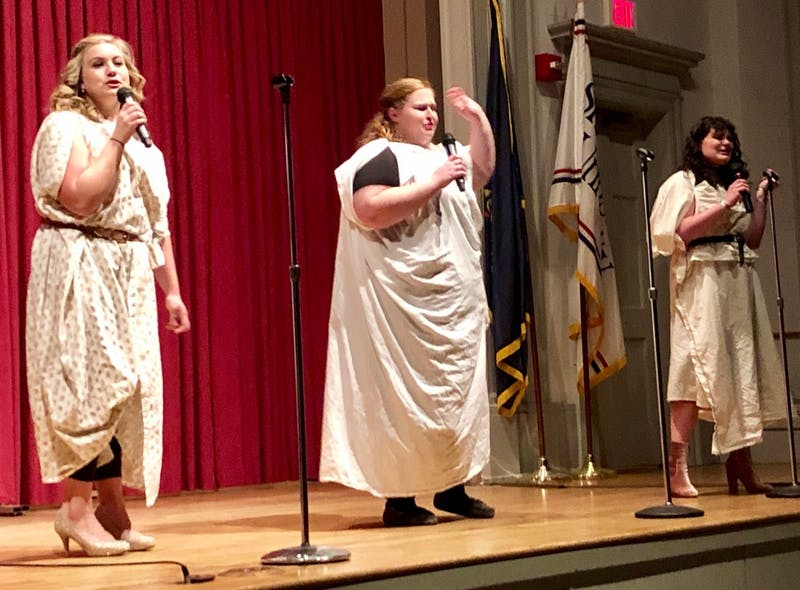 "(Left to right) Madeline Schuler, Sierra Groft and Katherine Hargrove wear togas to perform ""Zero to Hero"" from the 1997 animated Disney movie ""Hercules."""