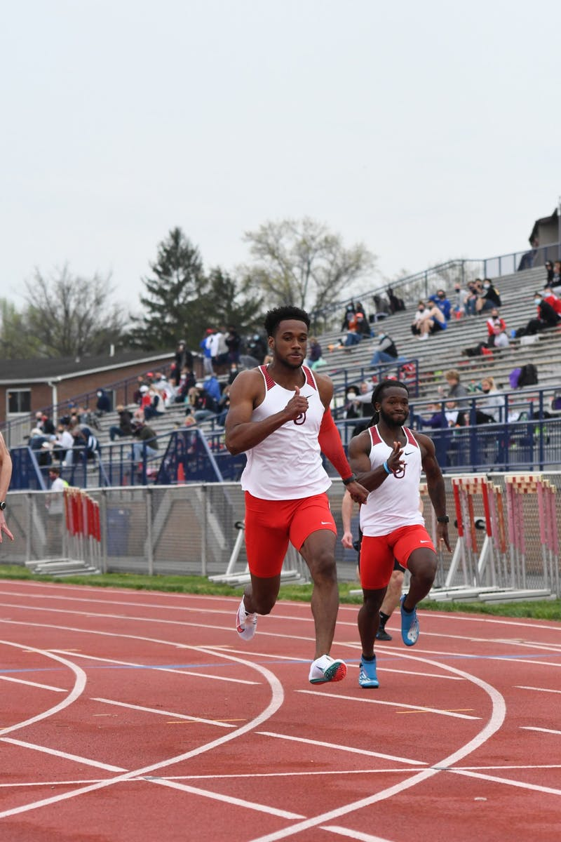 Eric Kirk and Michael Lingard compete in the 100-meters Wednesday at SU's Midweek Invitational.