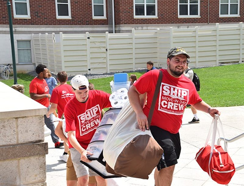 Move-in day crews help first-year students unpack their belongings to move into their new home at Shippensburg University. This is an effort to help new students better adjust to campus life and build bonds with returning students.