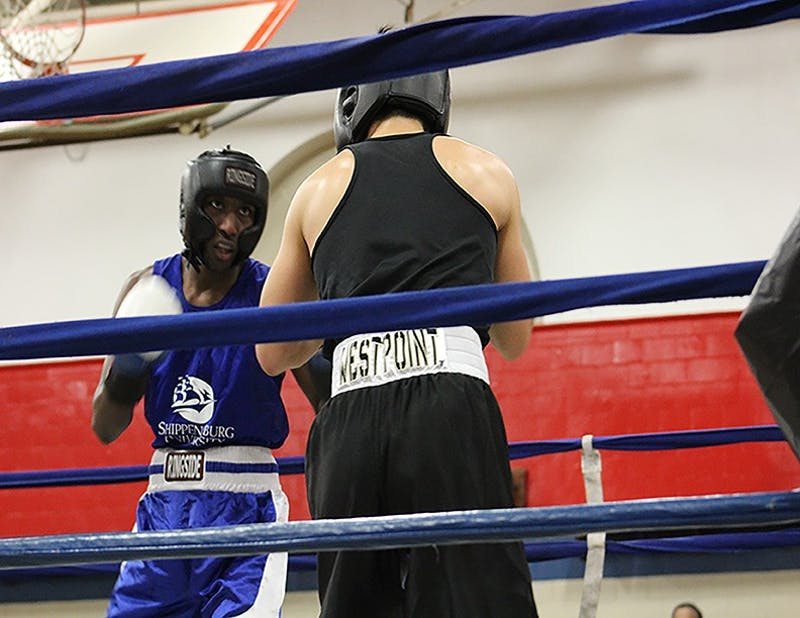 Tylik Guilford, left, captured a Raider victory against Army in the main event of the SU boxing club's show Thursday night at Henderson Gymnasium.