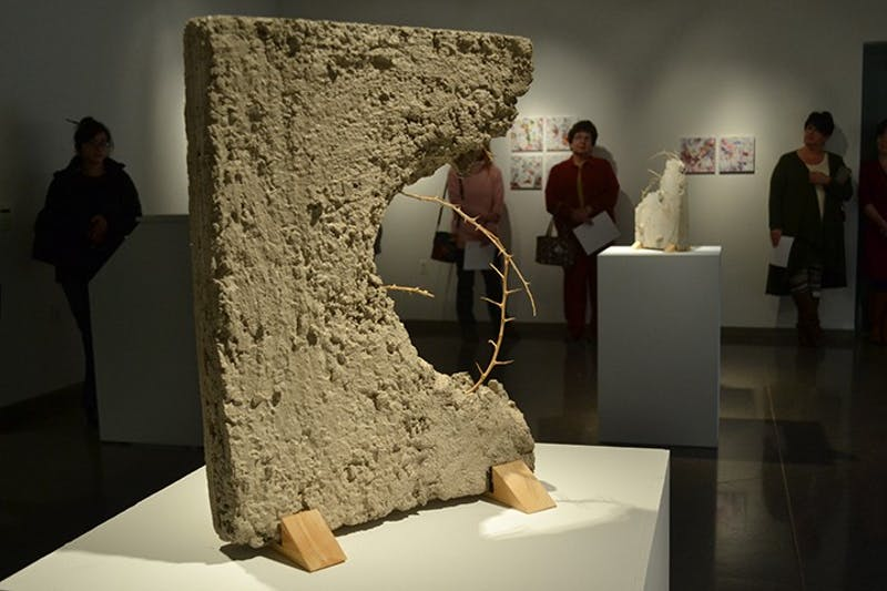 "Bethany Inman addressed the issue of the persecuted church in her ""Senior Exhibition"" display. The theme can be seen above as the thorns emerging from the cement sculpture represents martyrdom."