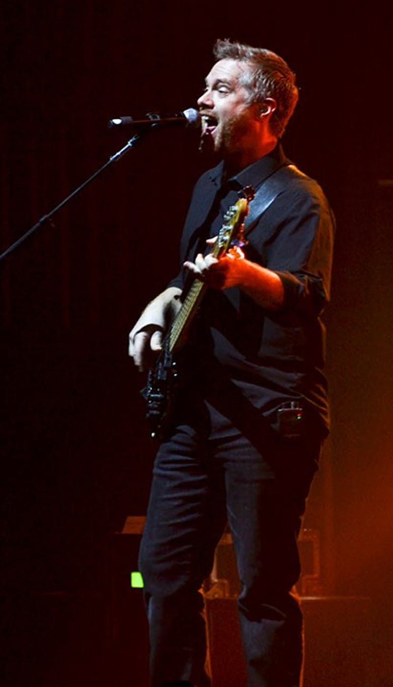 Brit Floyd bass guitarist Ian Cattell fills the place of Pink Floyd's original bass guitarist Roger Waters.
