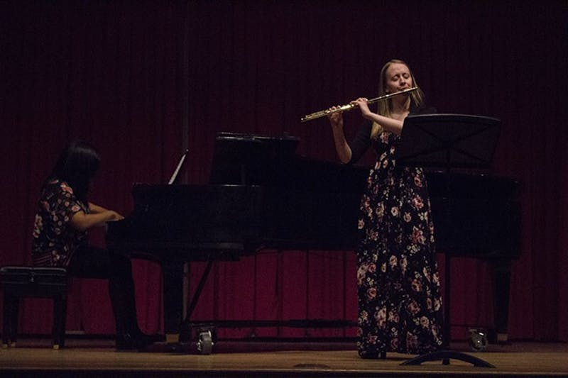 Young musicians Emma Resmini and Michelle Cann highlight eachother's exceptional musical abilities by meshing the sounds of flute and piano during the performance of several collaborative songs.
