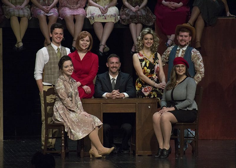 Justin Persicketti, Sophia Jones, Nick McKim, Hannah Famulare, Tyler Rock (Back, left to right) and Maggie Haynes and Mallory Kravitz (front, left and right) around Franklin Hart's desk. The show revolved around strong  female leads, both in the personality and in the vocal dynamic of the singers.