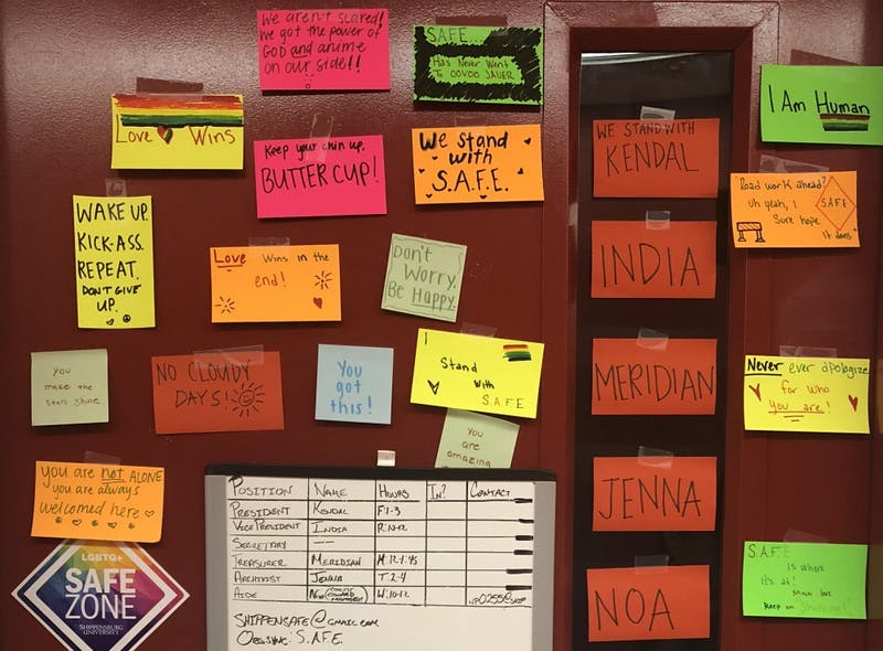 SAFE members decorate the door of their meeting room in the CUB with kind and uplifting words in response to a vandal's hateful words last week.
