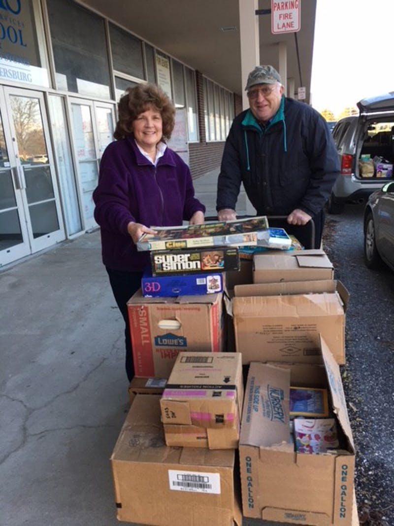 Friends of Legal Services volunteers Linda and Mike Metcalfe haul a few of the 50,000 books that have already been donated for the 34th Annual Friends of Legal Services Book Sale, scheduled for Friday, May 18 through Sunday, May 20 on the Wilson College campus in Chambersburg. The book drive ends on April 15.