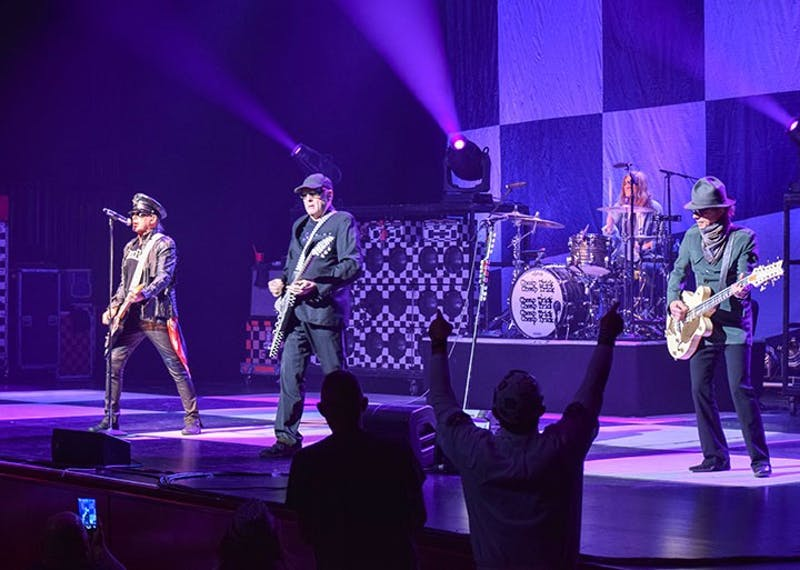 Cheap Trick fans amp the band up with their festive checkered apparel, excited shrills and dance moves.
