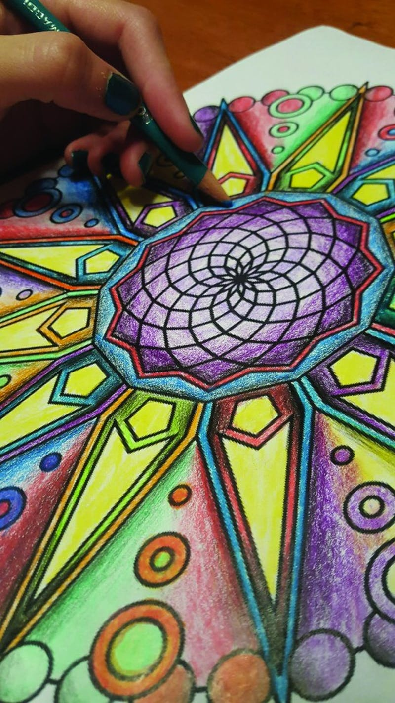 Students color mandala designs as a form of meditation to relieve stress.