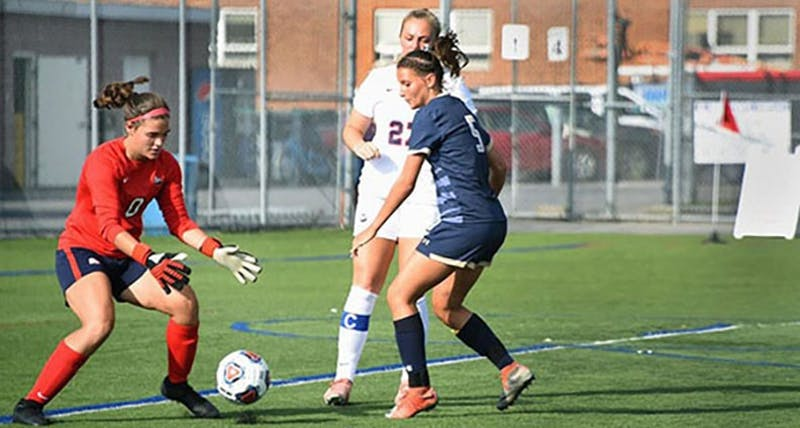 Delaney Shifflett, pictured on the left, has improved drastically from her freshman season last year. Shifflett made six saves, but she allowed the game's only goal on Saturday. The Raiders are 3-1, and Shifflett's improved play in goal has been a major reason for the team's fast start to this season.