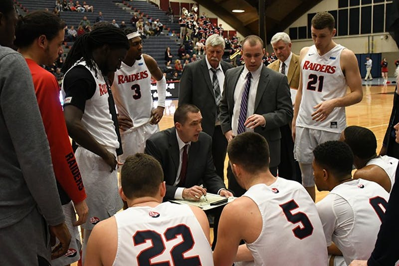 SU head coach Chris Fite going over something in the huddle during a PSAC Tournament game. Multiple players credited Fite's preparation and game planning after the win over Mercyhurst in the PSAC Semifinals.
