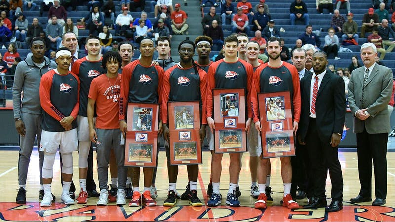 The men's basketball team honors its group of seniors with plaques on senior night at Heiges Field House. The Raiders defeated Shepherd University 66-59 behind major defensive contributions from Lamar Talley. Standing with the plaques, from left to right, are Talley, Daylon Carter, John Castello and Derek Ford.