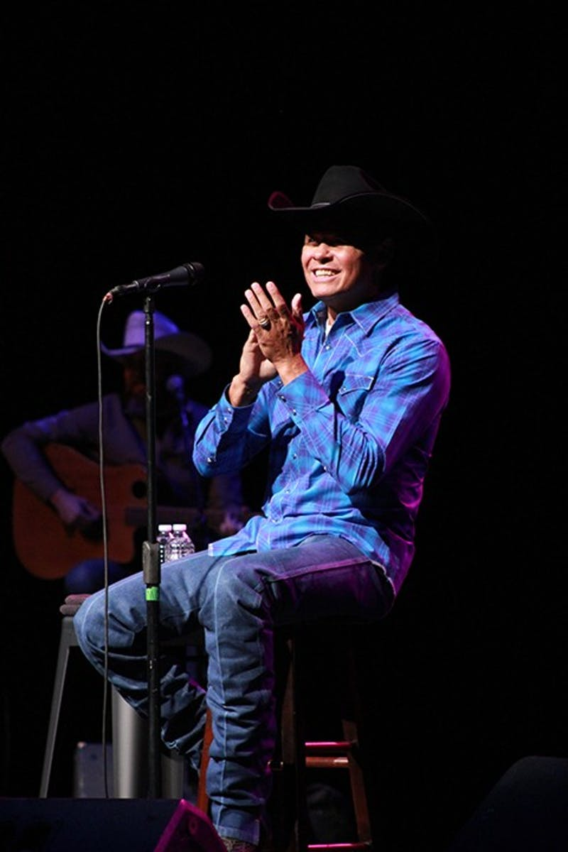 "Neal McCoy dances and rocks on his stool, bringing energy to the stage. McCoy is well-known for hits such as ""Wink"" and ""Billy's Got His Beer Goggles On,"" which he sang at the concert Sunday night."