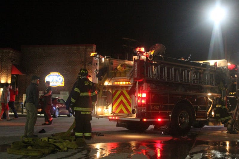 A vehicle caught fire on North Queen Street. Fire engines park at Sheetz to gain access to the vehicle.