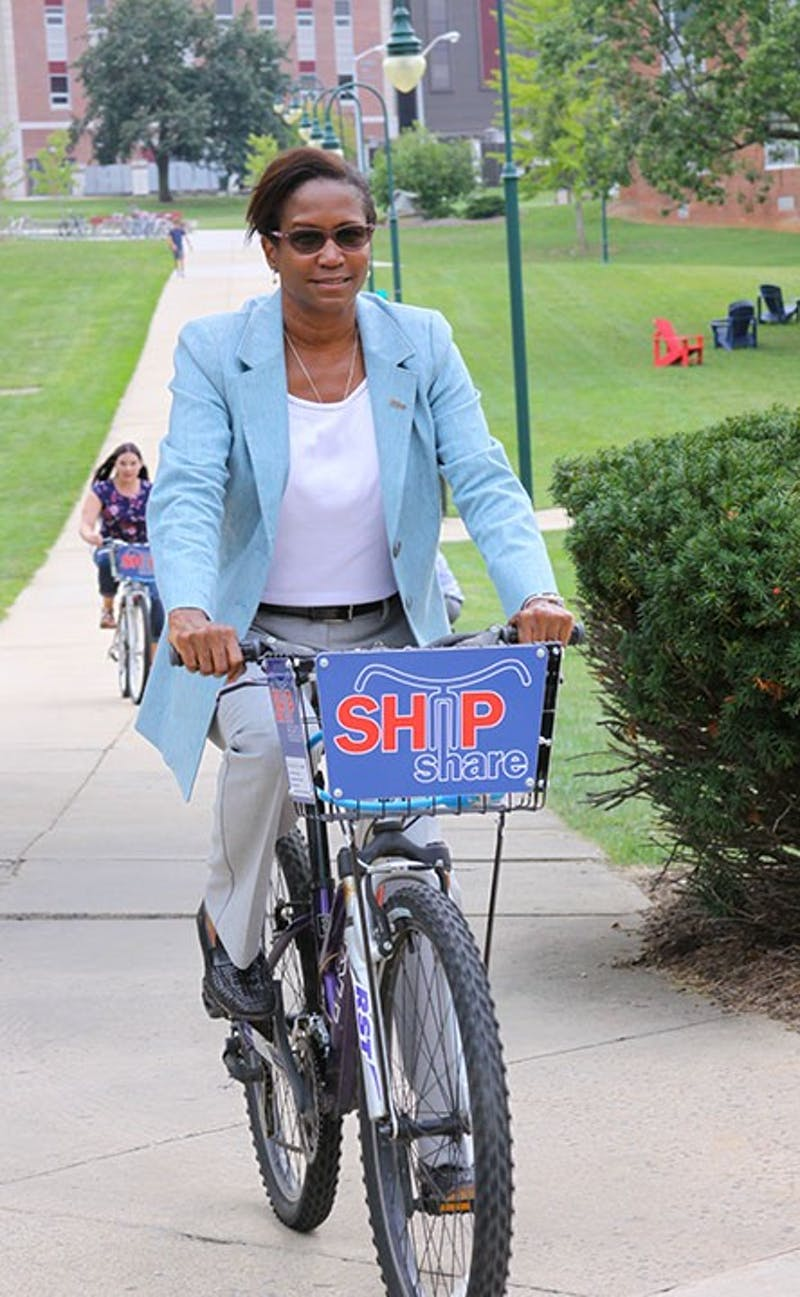 President Carter and members of Student Government complete a lap around the academic quad as some of the first members of SU's community to take part in the ShipShare program. The program allows students, faculty and staff to rent bicycles to ride on campus, in town or on the rail-trail.