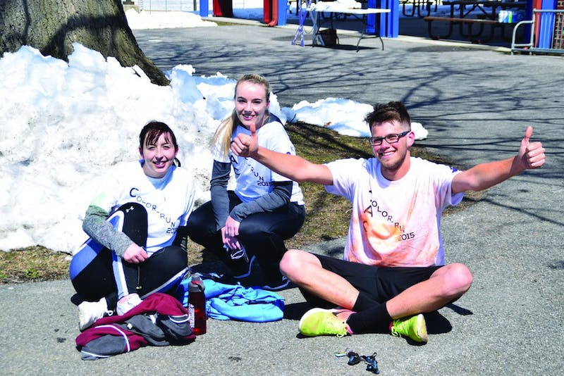 Olivia Magallanes (left) won second place Sunday, while Courtney Schlusser and Lucas Strayer tied for first place at Colleges Against Cancer's 5K Color Run.