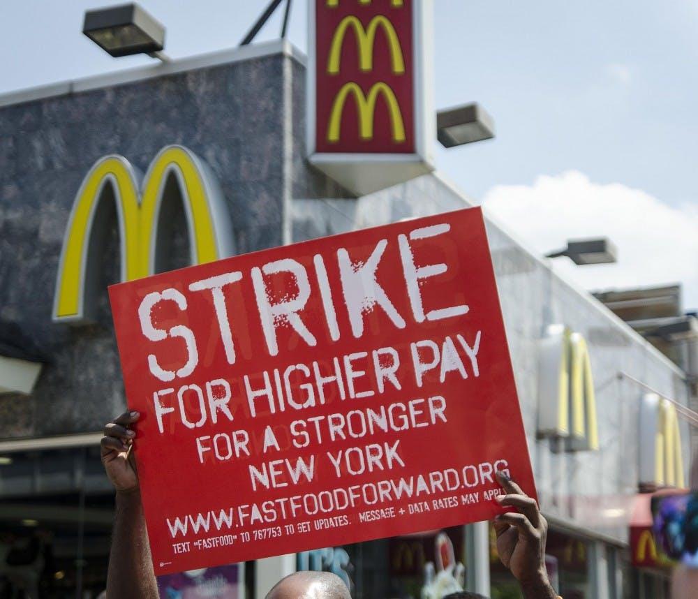 Seattle to increase minimum wage