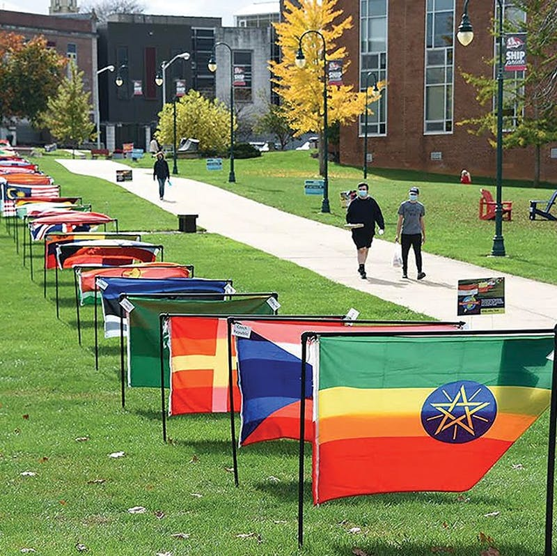 The international flag display is set up in the academic quad for International Education Week.