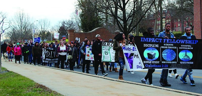 """Members of the campus community chant """"No struggle, no progress"""" as they march during the 33rd Annual Martin Luther King Jr. March for Humanity."""