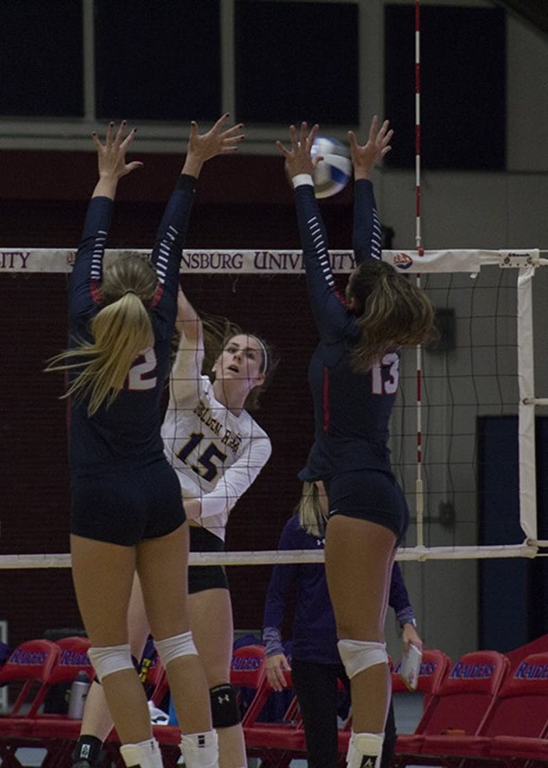 Samantha Webber (No. 12) and Emily Hangen (No. 13) rise up to block a shot.