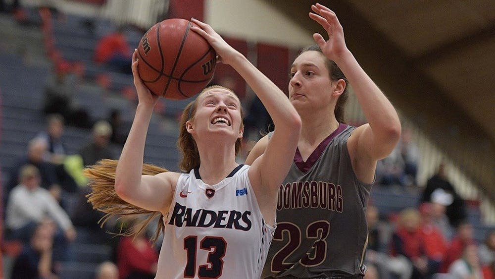Raiders advance to PSAC Semifinals, Young reaches 1,000 career points