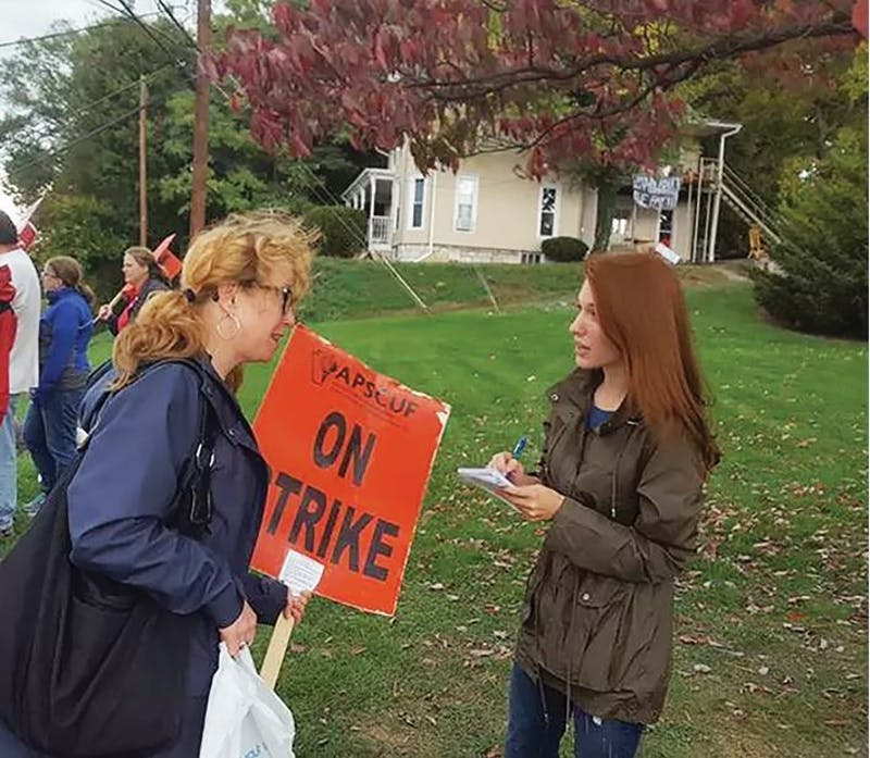 Asst. PR Director Sylvia McMullen interviews an SU faculty member during APSCUF's strike, which lasted for three days.