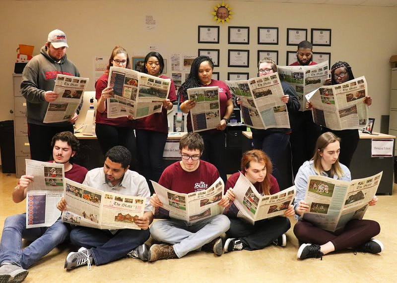 Some members of the 2019-2020 staff of The Slate pose with their favorite editions.