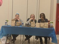 The judges, including SU President Laurie Carter (right), had an hour and a half to de- cide which cookie they thought should go home with the top award of the night.