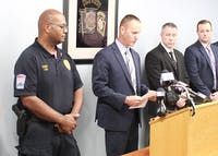 State Police Lt. Mark Magyar (second from left) announced charges Tuesday in the shooting incident in Shippensburg Sunday night.