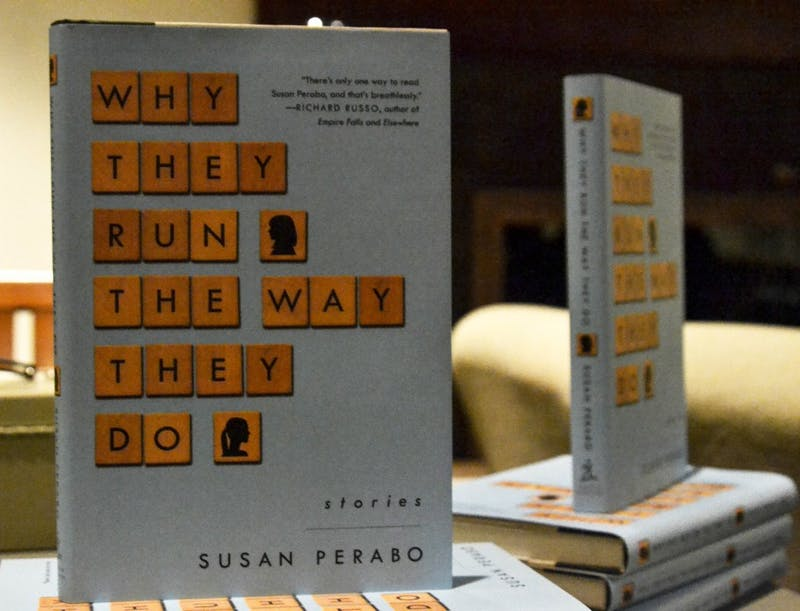 """Susan Perabo, English and creative writing professor at Dickinson College, has published many books, including, """"Why They Run The Way They Do,"""" which she shared with SU students."""