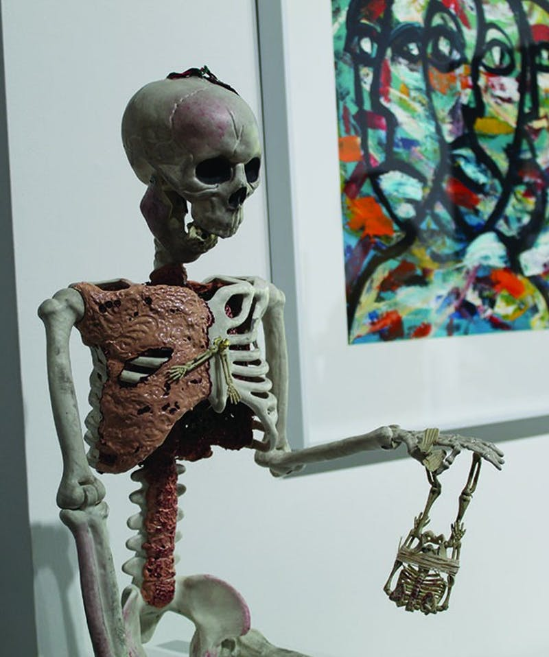 """A real clock is installed on the outside of the skeleton that viewers can hear tick when standing near. Swenson found that skeletons are used often to depict time, giving the inspiration for her sculpture of skeletons, """"Father Time."""""""