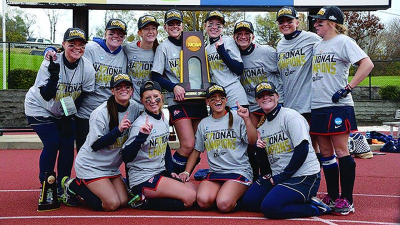 Shippensburg University's senior class (and goalie Ally Mooney) pose with the 2017 NCAA National Championship trophy after defeating LIU-Post on Nov. 19.