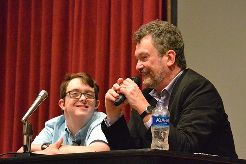 Jamie Bérubé (left) and Michael Bérubé talk to the audience Tuesday evening about struggles Jamie and other people with disabilities face, including trying to find a job and gaining work experience.
