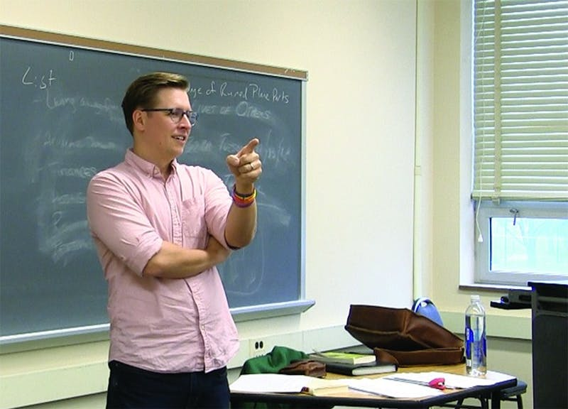 English professor Jordan Windholz splits his UNIV 101: First Year Seminar students into groups to discuss their reading assignment. His section of the course focuses on poetry's utility in society, which he says is going well so far.