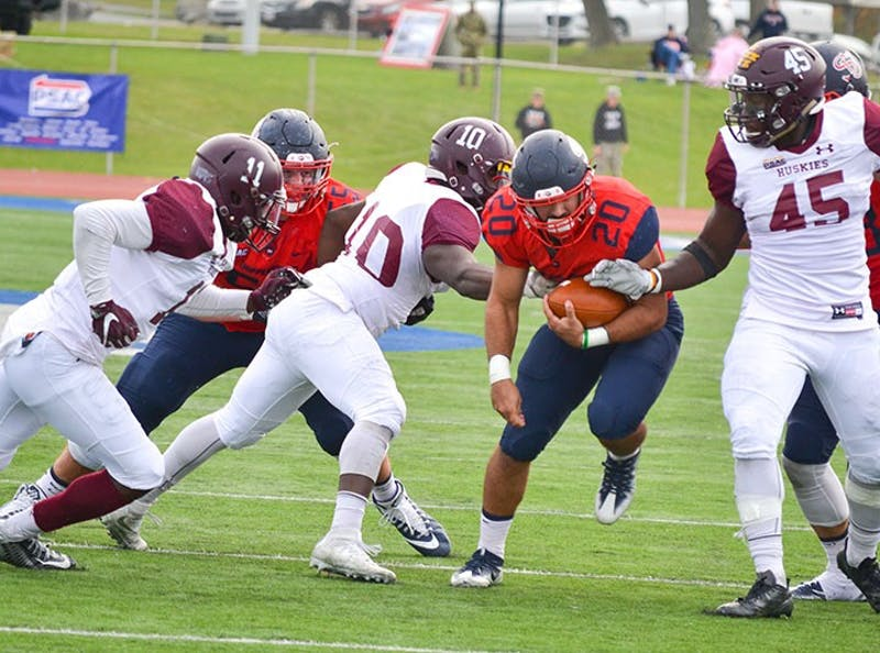 SU's Colin McDermott rushes through a hole in the Bloomsburg defense on Saturday at Seth Grove Stadium. McDermott rushed for 65 yards in the win.