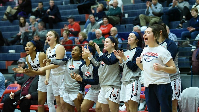 The Raider bench celebrates a shot made in SU's convincing 83-61 win Wednesday night. SU extended its lead in the PSAC Eastern Division to two games after last week's wins over West Chester and Mansfield.