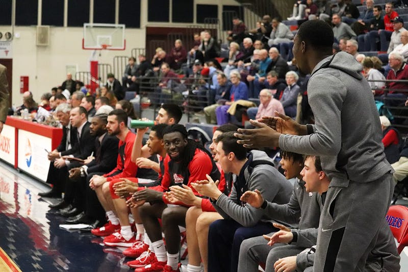 The Raider bench reacts to a bucket during SU's victory over Kutztown University at Heiges Field House. Head coach Chris Fite praised his bench unit after the game, citing the team's depth and balance as a key reason for its early success.