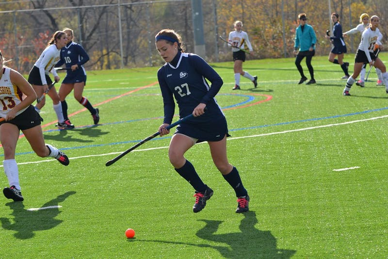 Raider senior Brittany Jett moves the ball down the field for SU during their game on Friday afternoon.