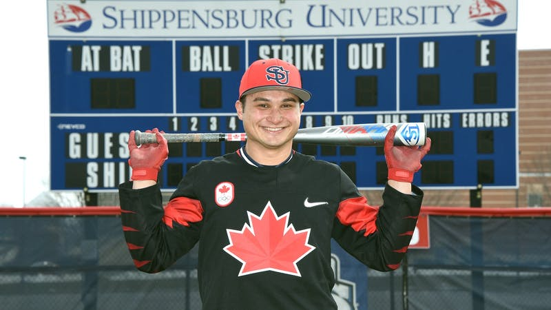 Tony Vavaroutsos dons a Canadian baseball jersey with his SU Raiders hat at the team's media day before his freshman season.