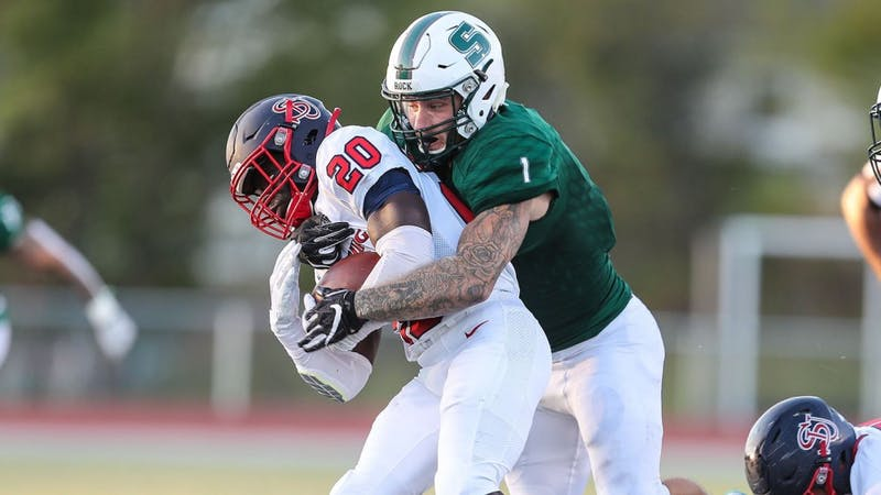 Raiders running back Bill Williams is wrapped up by a Slippery Rock defender Saturday evening. The redshirt freshman didn't have much room to run. He totaled just 39 yards on 11 carries against The Rock.