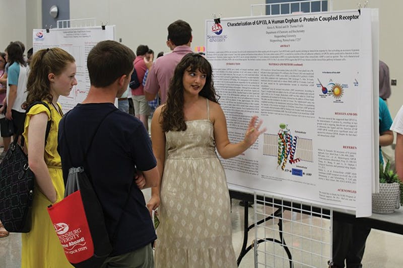 "Alexis Weitzel speaks with new  students about her Summer Undergraduate Research Experience (SURE) project. Weitzel studied ""Characterization of a Human G protein-coupled receptor."" SURE student and faculty researchers presented Thursday during the Success Now! Expo during fall Welcome Week."